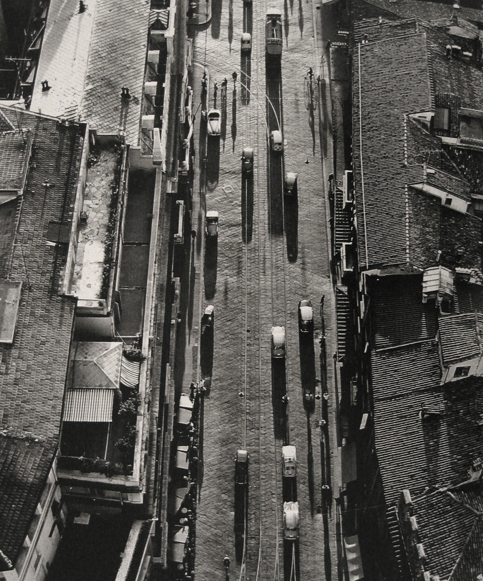 Nino Migliori, Bologna, 1958. A street with vehicles photographed from above.