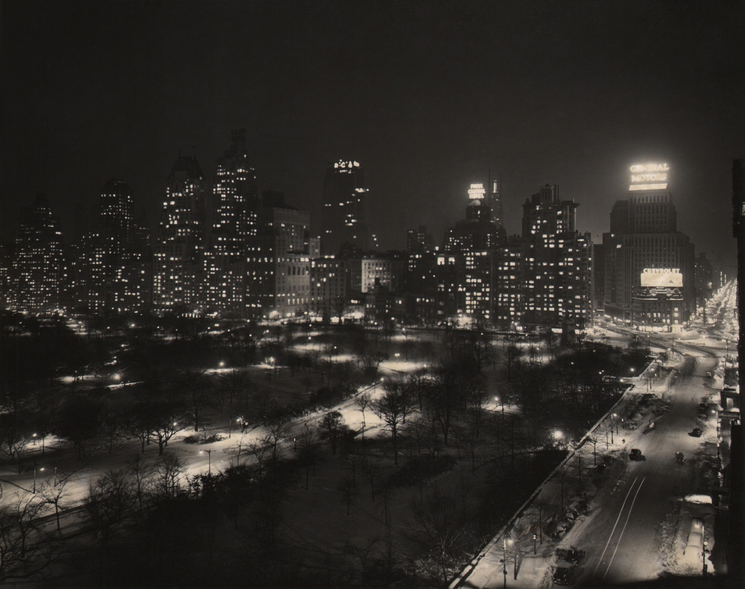 Paul J. Woolf, Central Park South & West, c. 1935. Night time cityscape with park on lower left, street running up the right of the frame, and buildings across the middle of the frame.