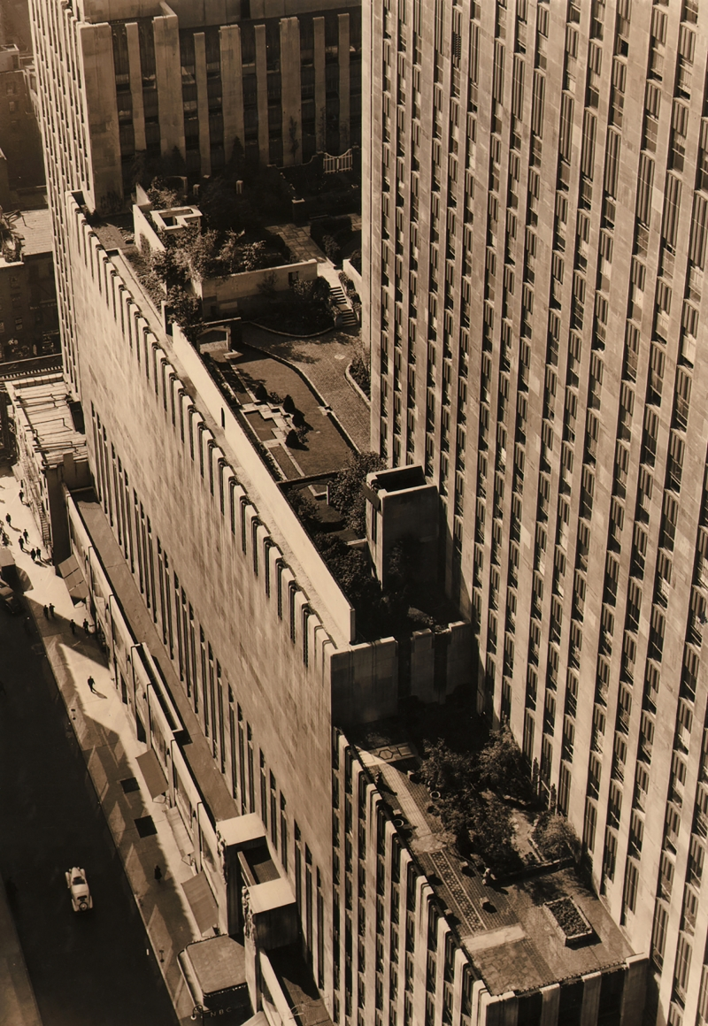 Paul J. Woolf, Hanging Gardens at Rockefeller Center, c. 1935. Elevated courtyard photographed from above, street runs up the lower left of the frame.