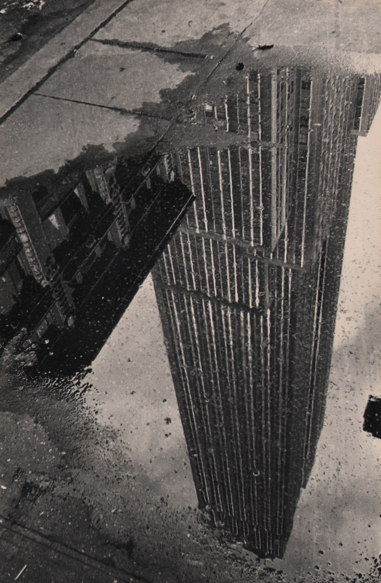 29. Fritz Neugass, Reflections: Empire State Building in a Rain Puddle, c. 1948. Upside-down reflection of the Empire State Building, imaged in a sidewalk puddle.