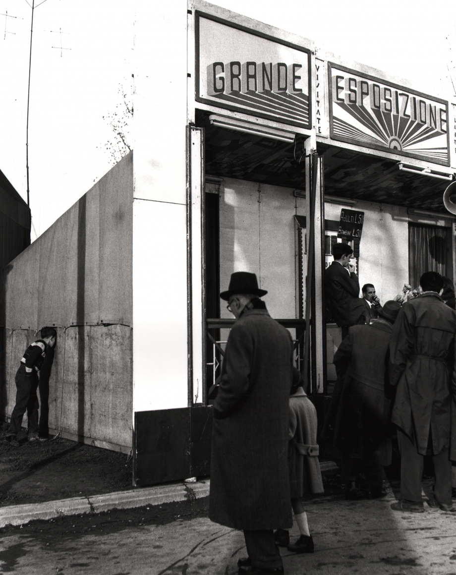 "Nino Migliori, People of Emilia, 1950. Patrons gathered outside a building marked ""Grande Esposizione"""
