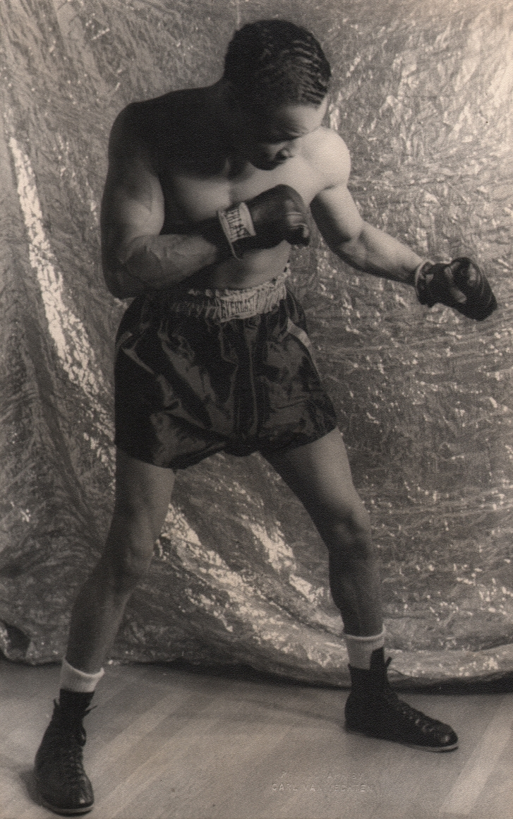 Carl Van Vechten, Henry Armstrong, 1937. Subject holds a boxing pose in front of a reflective backdrop.