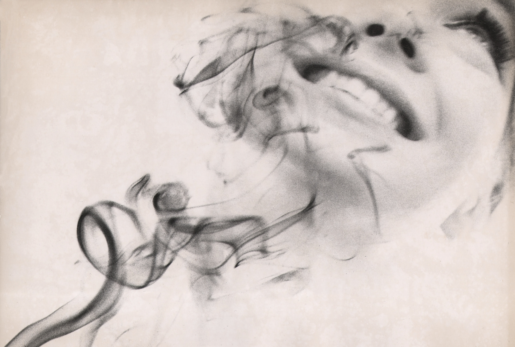15. David Attie, Saloon Society, 1959. Composite photo featuring wisps of smoke and a smiling woman's face.