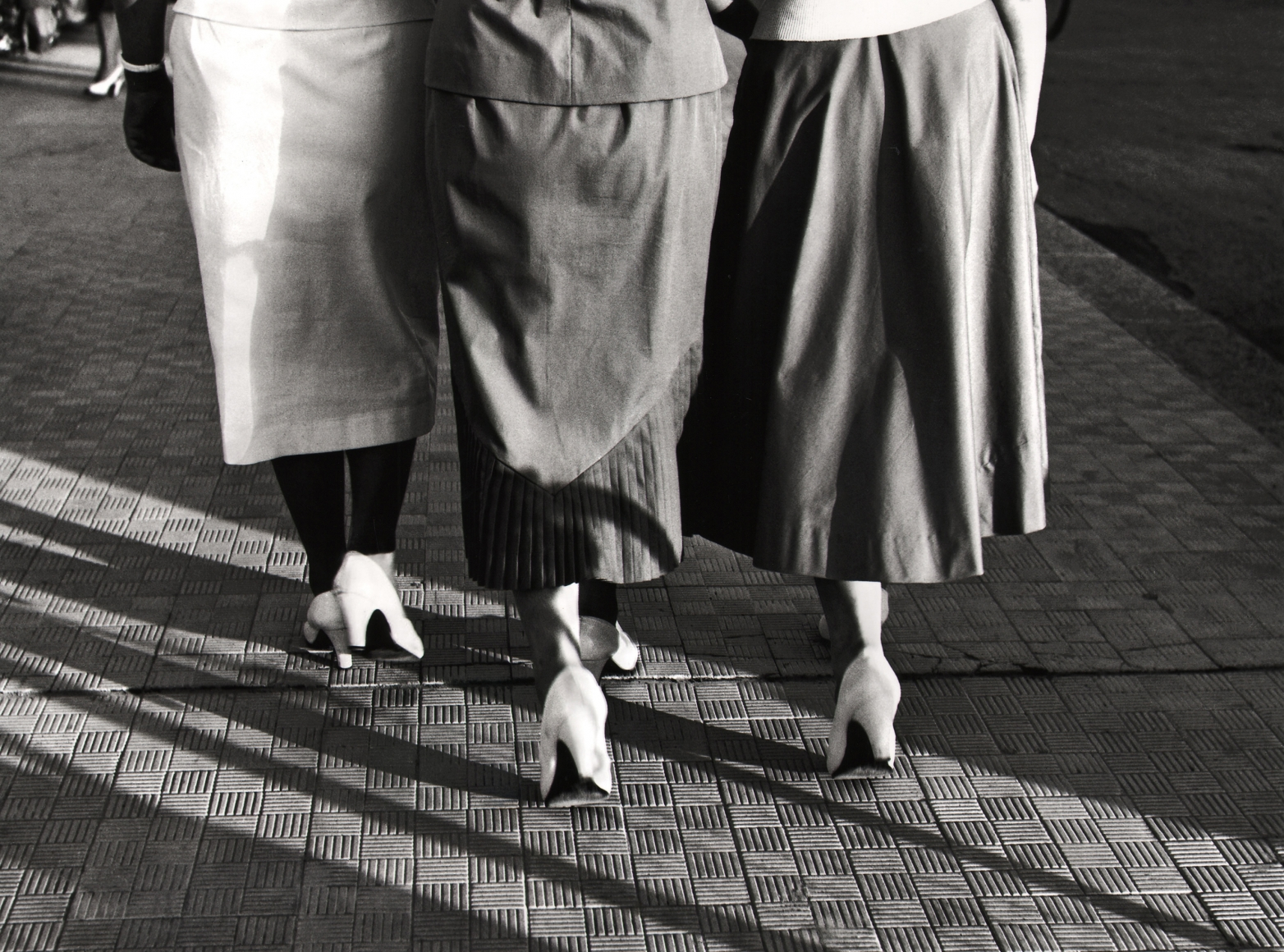 Nino Migliori, White Shoes, 1951. Three women photographed from behind from the waist down in matching white heels.