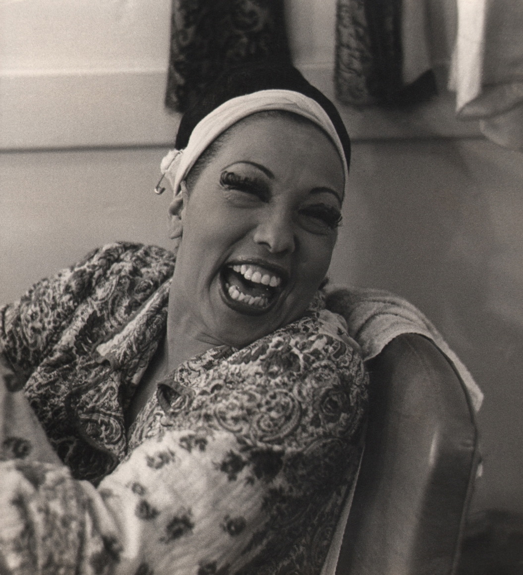 Florence Homolka, Josephine Baker, c. 1958. Subject is pictured seated and smiling, looking off to the right.