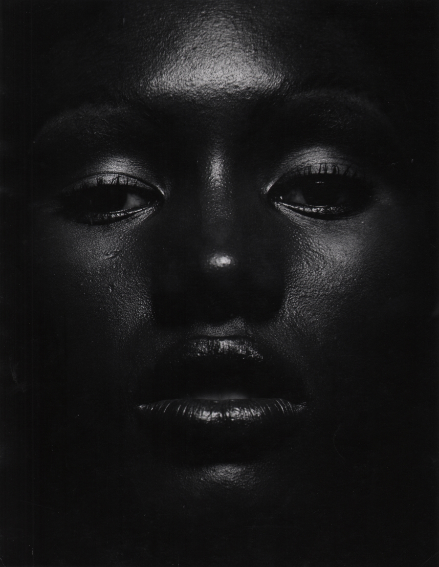 07. Anthony Barboza, Grace Jones, 1970s. Close up of the model's dimly-lit face, eyes looking to the camera and lips slightly parted.