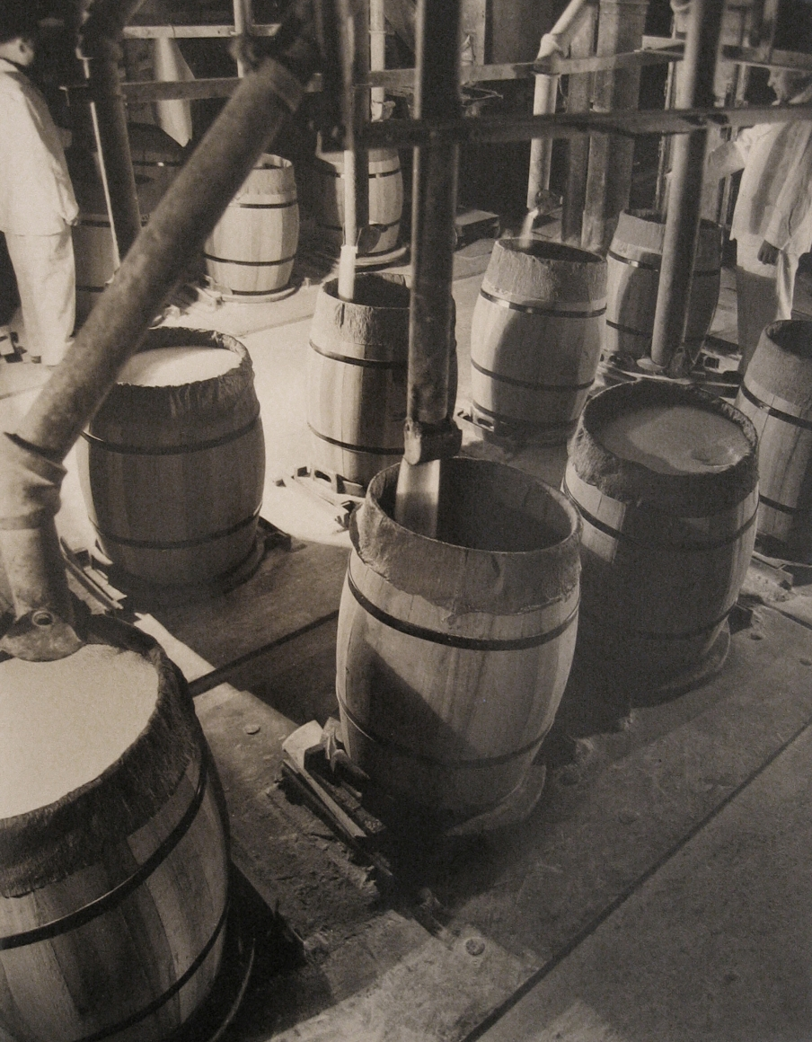 Harold Haliday Costain, Edgewater, NJ Sugar Refinery, 1935. Barrels are filled with sugar via vertical pipes.