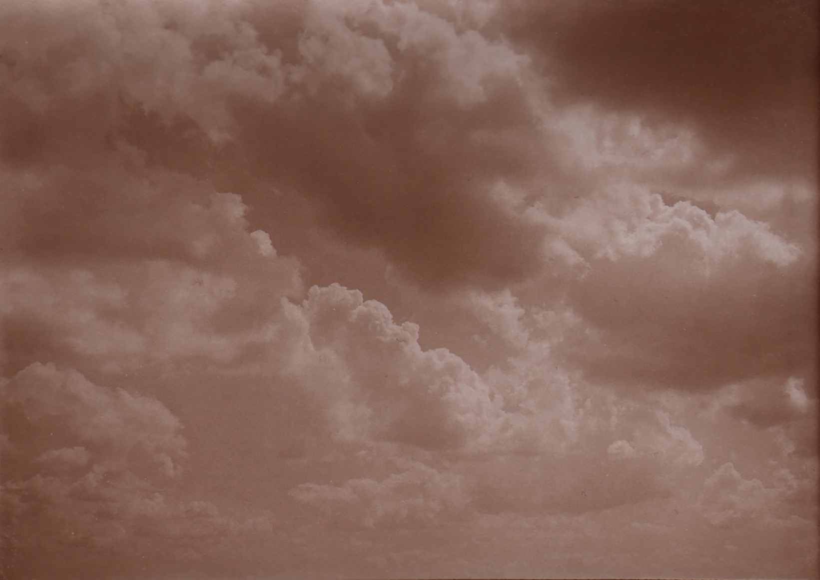 31. Léonard Misonne, Untitled, c. 1930. Cloud-filled sky. Sepia-toned print.