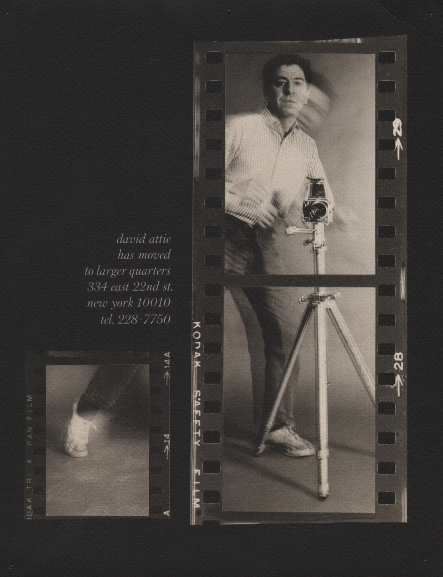 """01. David Attie, Self-Portrait, c. 1965. Contact sheet with two strips of film against black. The photographer, blurred with motion, stands behind a tripod. A message on the left reads """"david attie has moved to larger quarters 334 east 22nd st. new york 10010 tel. 228-7750"""""""