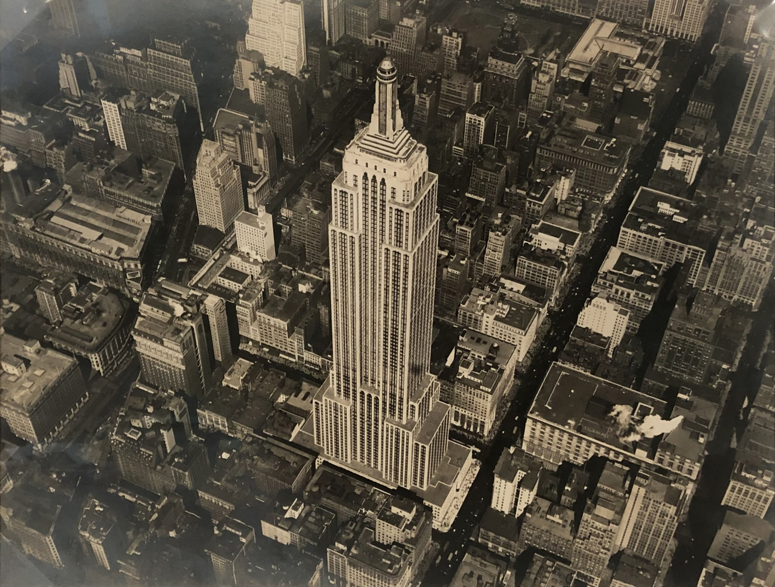 23. Fairchild Aerial Surveys, Empire State Building, 1931. Aerial view of the completed Empire State Building from above and to the right. The building occupies the center of the frame.
