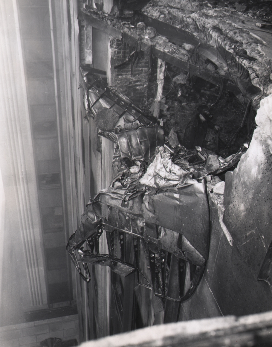 05. Acme Newspictures, Plane Wreckage Clings to Empire State Building, 1945. Close-up of damaged building facade with metal protruding from the hole.
