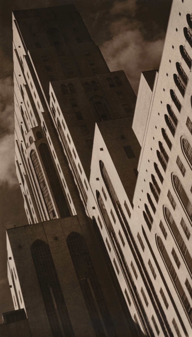 Paul J. Woolf, New York Hospital, c. 1935. Diagonal composition upper left to lower right, looking up at hospital building with cloudy skies behind.