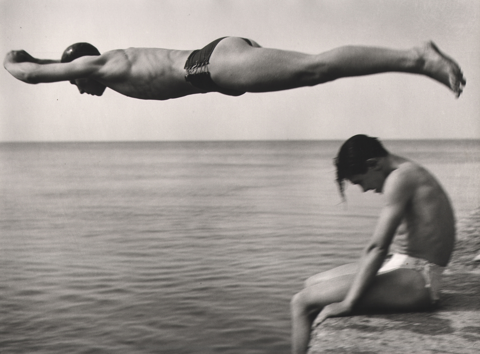 Nino Migliori, The Diver, 1951. One man jumps over another into the ocean.
