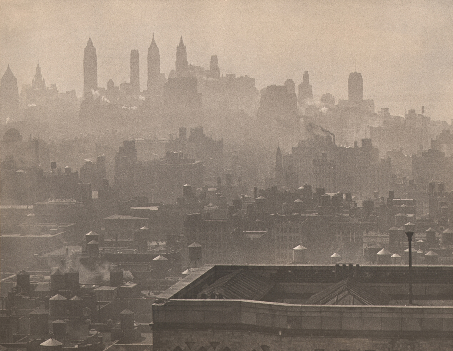 Paul J. Woolf, City Symphony, c. 1935. Hazy cityscape with a nearby rooftop in the foreground right and semi-obscured skyscrapers silhouetted in the mid- and background.