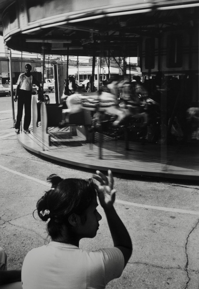 Woman and Carousel, Coney Island, 1976, Gelatin silver print, printed c. 1976