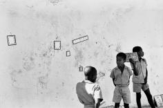 Burk Uzzle, 3 Boys with Wall
