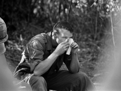 John Nance- Pfc. Clark Richie Sniffs the Scent of a Letter from a Girl Back Home in Jay
