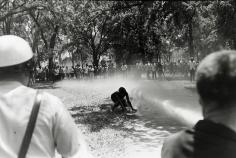 Bob Adelman - Demonstrator knocked down by fire hose, Kelly Ingram Park, Birmingham, Alabama - Howard Greenberg Gallery
