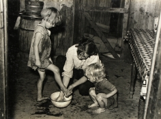 Russell Lee - Mother Washing Daughter's Feet in shack Home, c.1938 - Howard Greenberg Gallery
