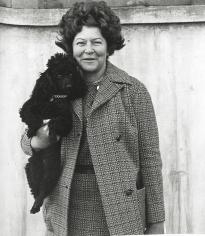 David Goldblatt - A Woman and Her Dog, Hillbrow, June 1972 - Howard Greenberg Gallery