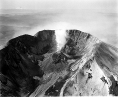 Frank Gohlke - Aerial View of Mt. St. Helens, Crater and Lava Dome, Airplane in the Center, Mt. Hood and Mt. Jefferson in the Distance, 1982 - Howard Greenberg Gallery