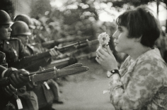 Marc Riboud - Confrontation between a flower and the bayonets of soldiers guarding the Pentagon during the March for Peace in Vietnam, Washington, D.C., 1967 - Howard Greenberg Gallery