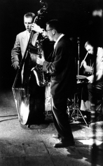 Sy Kattelson - Red Mitchell on bass, Lee Kanity on sax, and Jeff Martin on drums at 1st Newport Jazz Festival, 1954 - Howard Greenberg Gallery