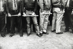 Bob Adelman - Sheriff deputies hold billy clubs to control demonstrators in black part of tow - Howard Greenberg Gallery
