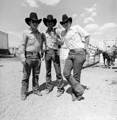 Tom Arndt - Three cowboys, Cheyenne, Wyoming, 1975 - Howard Greenberg Gallery