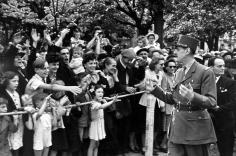 Robert Capa - General Charles de Gaulle leading Parade, 1944 - Howard Greenberg Gallery