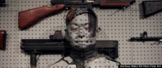 Huffington Post: Liu Bolin's Gun Rack Performance