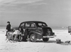 Marion Post Wolcott, Winter Visitors Picnic on Running Board of Car, Sarasota, Florida, 1941, 11 x 14 inch Gelatin silver print, Signed on verso