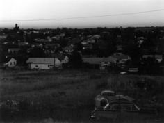 Robert Adam, Dusk, West Denver, Colorado, 1973, 6 x 7 inch gelatin silver print. Printed in 1988., Signed, titled, and dated on verso, LUM24613