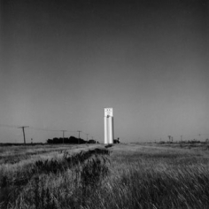 Frank Gohlke, Grain Elevator, Series III-Haggard, Kansas, 1973, 9 x 9 inch vintage gelatin silver print.  Printed in 1974, Signed, titled, dated and annotated on verso, LUM26408