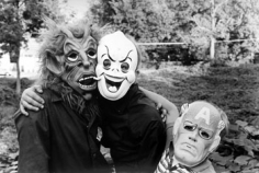 Three Kids with Masks, 1986, 14 x 11 inches, gelatin silver print