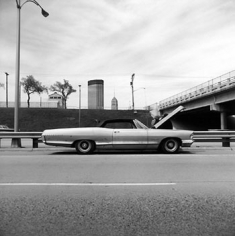 Frank Gohlke, Car Stopped on the Freeway, Minneapolis, 1974, 14 x 14 inch Gelatin silver print, Signed, titled, dated and annotated in pencil on verso, Signed, 2005