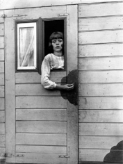 August Sander, Girl in circus caravan, 1926, image 10.5 x 8 inches/mount 17.25 x 13.25 inches, Gelatin Silver Print, Signed on verso by Gerd Sander, estate stamp also on verso, Edition 11/12, Illustrated: August Sander - Citizens of the Twentieth Century, pg. 349