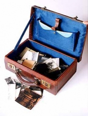 Leather suitcase with prints