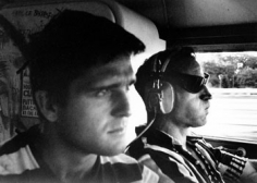 """Allen Ginsberg, Ken Babbs, Captain of Ken Kesey's """"Trips Festival"""" Bus, Co-piloting Neal Cassady, 1964, 11 x 14 inch Gelatin silver print, Ginsberg Trust stamp, signed in pencil by Bob Rosenthal, Edition of 3"""