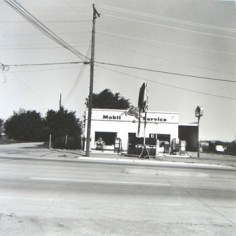 Ed Ruscha, Mobil, Shamrock, Texas, from Five Views from the Panhandle, 1962/2007, Suite of 5 7.5 x 7.5 inch Gelatin silver prints, Signed and editioned on the colophon page in linen clamshell case with silver embossing (sold only as full suite of 5)