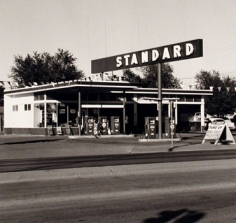 "Ed Ruscha, ""Standard- Amarillo, TX,"" 1962/1989, from the ""Gasoline Stations"" portfolio, Gelatin Silver print mounted on board, 19 1/2 x 23 inches, Edition of 25"