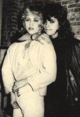 Supermodel Gia Carangi and makeup artist Sandy Linter in the men's room of Mudd Club, late 1970s