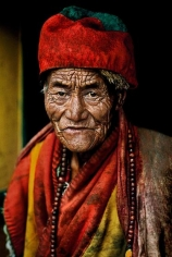 , Steve McCurry, Monk at the Jokhang temple, Lhasa, Tibet, 2000, ultrachrome print, 24 x 20 inches/60.96 x 50.8 cm; © Steve McCurry