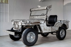 In God We Trust, 2009, stainless steel, handcrafted metal embellishments & jeep parts, 70.9 x 136.6 x 70.1 inches/180 x 347 x 178 cm