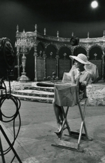 Audrey Hepburn seated on the set of Paris When It Sizzles, 1962