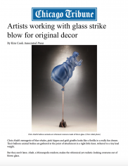 Artists working with glass strike blow for original decor