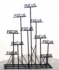 "Focus, Focus, Focus, 2009. Wood, hardware, hot glue, acrylic paint, 74 x 59 x 15 inches (overall) (188 x 149.9 x 38.1 cm); 15 inches (each ""Focus"") (38.1 cm). MP 55"