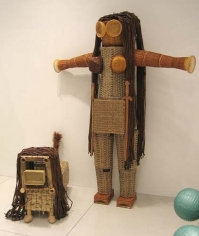 The Princess Warrior and Her Dog!, 2005. Baskets, wood beads, duster, wood shades, slippers, wood stands, warrior: 90 x 71 x 20 inches (228.6 x 180.3 x 50.8 cm); dog: 30 x 18 x 47 inches (76.2 x 45.7 x 119.4 cm). MP 8