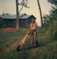 Boy with Wooden Bicycle,  Tanganyika (Tanzania), 1958
