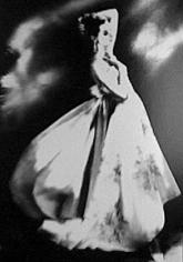 """""""Silk Organdie, Embroidered and Printed"""", Gown by Irene, Barabara Mullen, New York, Harper's Bazaar, July 1955, gelatin silver print, 14 x 11 inches"""